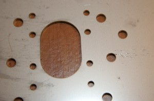 Detail of laser-cut stainless steel motor plate